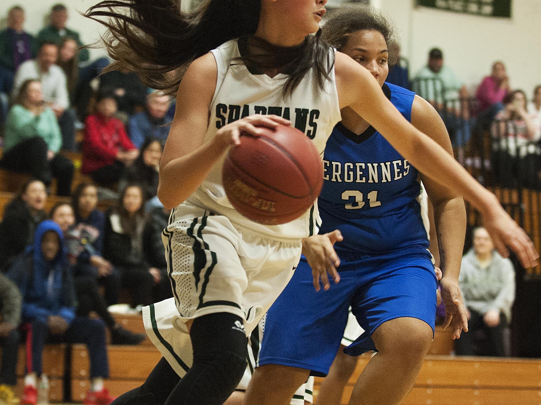 Winooski's Niki Dang (20) drives to the hoop during the girls basketball game between Vergennes and Winooski at Winooski High School on Wednesday.