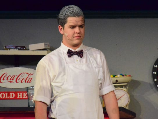 At the drugstore, Doc (Philip Allen) tries to talk
