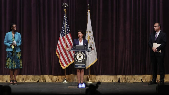 Gov. Gina Raimondo gives details of Rhode Island's Phase 3 emergence from its COVID-19 shutdown Monday afternoon in a briefing at Veterans Memorial Auditorium in Providence. On the left is Dr. Nicole Alexander-Scott, director of the state Department of Health, and at right Stefan Pryor, secretary of R.I. Commerce.