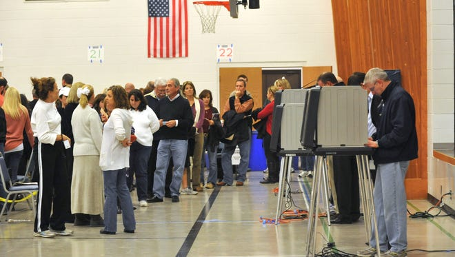 Voters lined up in the Parish Hall at Holy Spirit Catholic Church at Geist in Hamilton County on Nov. 6, 2012.