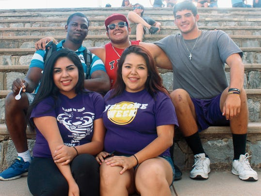 Western New Mexico University students Ada Mack, front left, Stephanie Baez, front right, and Derrick Uzoekwe, from left, back row, Chad Hutchinson, and Frank Martinez enjoy the music playingÊon Friday's rainy evening at the Live On The Lawn event.   Sky Klaus - Sun-News