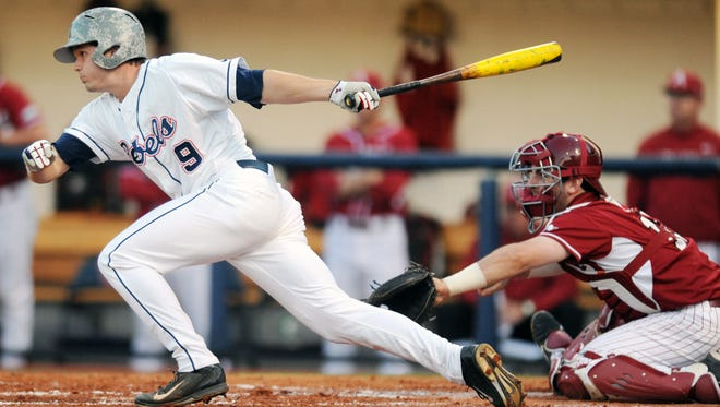 Mississippi's Auston Bousfield (9) hits an RBI-single as Arkansas catcher Jake Wise awaits the pitch during an NCAA college baseball game in Oxford, Miss., Friday, May 2, 2014. (AP Photo/The Oxford Eagle, Bruce Newman) MAGAZINES OUT; NO SALES; MANDATORY CREDIT