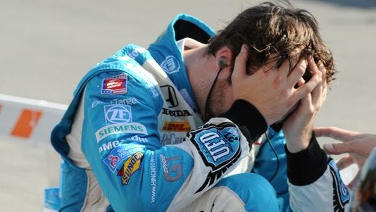 James Hinchcliffe holds his head after pulling off the course during the inaugural Grand Prix of Indianapolis.