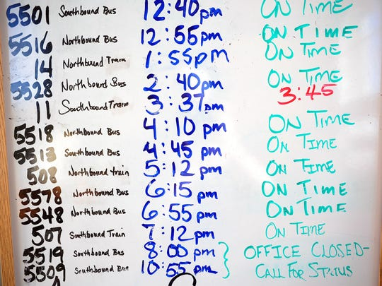 Departure times listed on a white board at the Amtrak counter, on Sunday at the Salem station. There may not be enough money in the state budget to keep the train running between Eugene and Portland.
