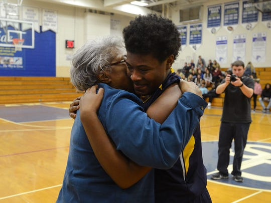 MOMENT OF THE WEEK: Pocomoke's Dynaisha Christian gets a hug from her grandmother after scoring her 1,000th career point Thursday night at Stephen Decatur in Berlin.