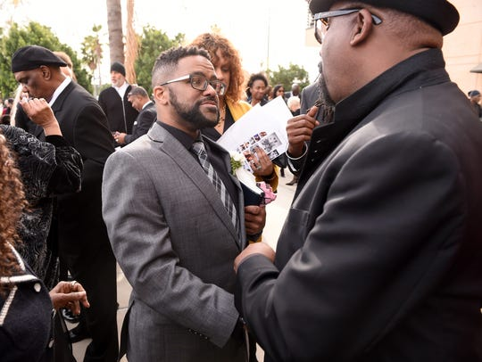 "Robert ""Robbie' Yancy greets guest at a Celebration"