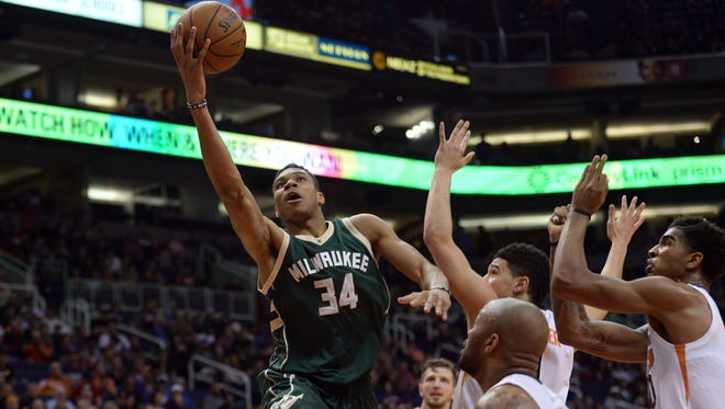 Bucks forward Giannis Antetokounmpo goes up for a layup Saturday against the Suns during Milwaukee's victory at Talking Stick Resort Arena in Phoenix.