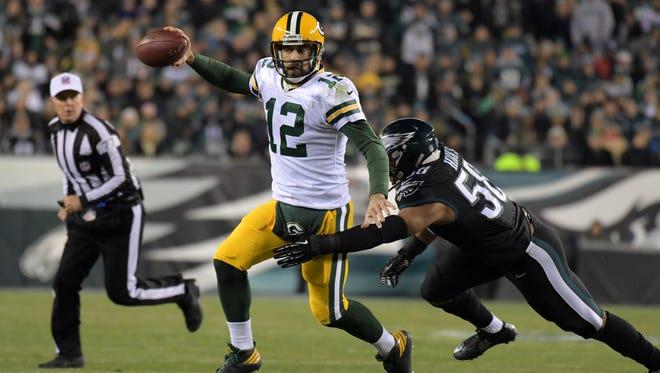 Quarterback Aaron Rodgers  is pressured by Philadelphia Eagles linebacker Jordan Hicks.