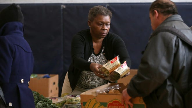 Tynia Feaster-Byrd lives in the Beechwood neighborhood and volunteers at Community Place on Mondays where she hands out food.  She also receives services at Community Place.