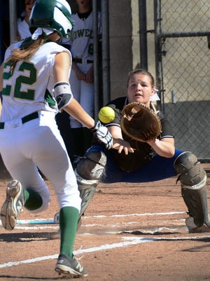 Lakeland catcher Rianna Koteles fields the throw at the plate in plenty of time to tag out Howell runner Emma Johnson (22).