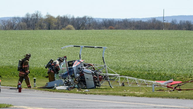 Emergency crews were dispatched to Deck Airport for a helicopter crash shortly after 11 a.m on Wednesday, April 20, 2016. Two people walked away from the crash, and the airport was expected to be closed for at least 48 hours, according to officials.