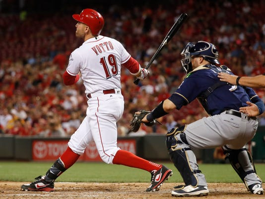 Cincinnati Reds' Joey Votto watches a solo home run off Milwaukee Brewers starting pitcher Jimmy Nelson during the seventh inning of a baseball game, Thursday, June 29, 2017, in Cincinnati. (AP Photo/John Minchillo)