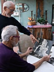 Geoffrey Webb and his partner Donald Beck look at photographs and reminisce Webb's earlier years as a stage and television actor, at their home in Palm Springs on Wednesday, Dec. 9, 2015.