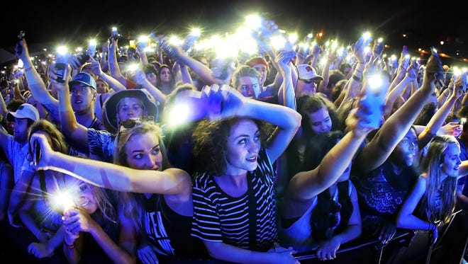 Yo Gotti fans wave their phones for the local favorite during the second evening of festivities at the Beale Street Music Festival on the Bud Light Stage.