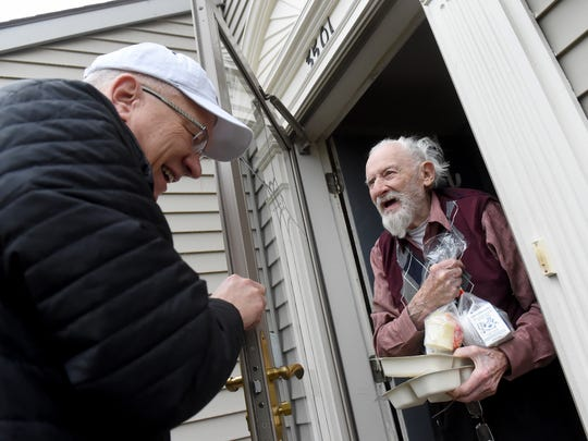 "Bob Bookwalter laughs as Wally Lamb, right, shares a story about his record collection on Friday, March 24, 2017. Bookwalter has been participating in the ""Meals on Wheels"" program for 10 years, delivering to seniors in the Shiloh and Dover area."