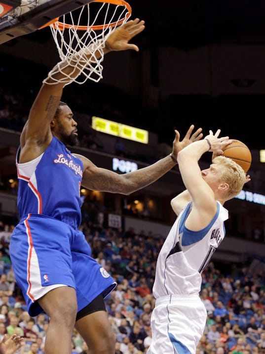 Minnesota Timberwolves forward Chase Budinger, right, is fouled by Los Angeles Clippers center DeAndre Jordan, left, during the fourth quarter of an NBA basketball game in Minneapolis, Monday, March 31, 2014. The Clippers won 114-104. (AP Photo/Ann Heisenfelt)