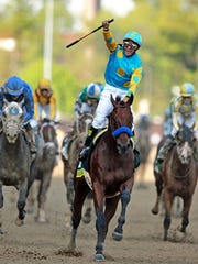American Pharoah wins the 141st Kentucky Derby.