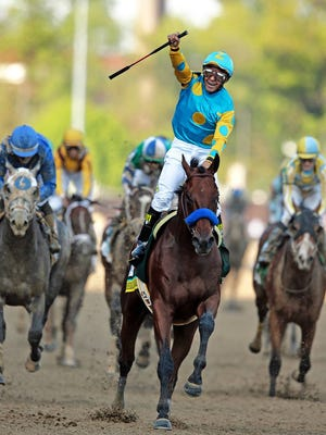 Jockey Victor Espinoza riding American Pharoah to victory in the 141st running of the Kentucky Derby horse race at Churchill Downs last May.
