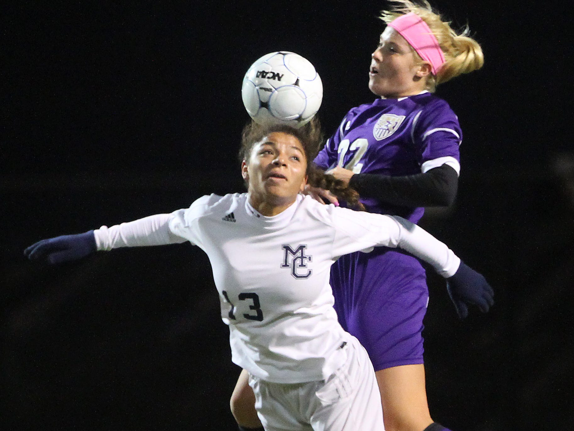 Morris Catholic's Rachel Mills goes for a header in a game against St. Rose in 2013.