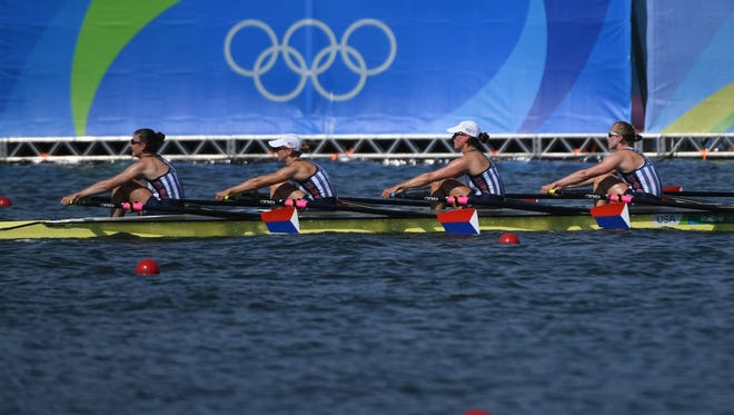 From left, Grace Latz, Tracy Eisser, Megan Kalmoe and Adrienne Martelli of the United States compete during the women's quadruple sculls rowing heats during the Rio 2016 Summer Olympic Games at Lagoa Stadium.