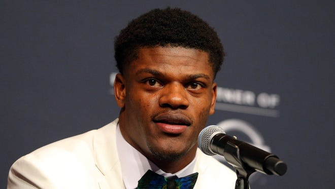 2017 Heisman Trophy finalist University of Louisville quarterback Lamar Jackson speaks to the media during the 2017 Heisman Trophy pre-announcement press conference at The New York Marriott Marquis.