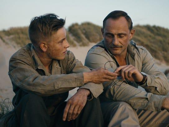 "Louis Hofmann (left) and Roland Møller star in ""Land"