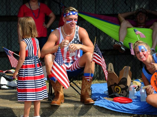 Dallin Bass and his sister Kate Bass, right, watch the Town of Farragut Independence Day Parade on July 4, 2016, on Kingston Pike.