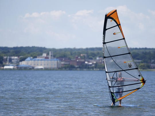 Doug Willard of Fairport windsurfs on Seneca Lake in