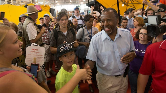 Republican presidential candidate, Dr. Ben Carson, greets fairgoers as he tours the Iowa State Fair in Des Moines on Sunday, Aug. 16, 2015.