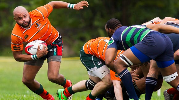 Wilmington's Kevin Wiggins breaks away from a scrum in the first half of Wilmington's 39-0 win over Severn River at Alapocas Run State Park in Wilmington on Saturday afternoon, September 12, 2015.