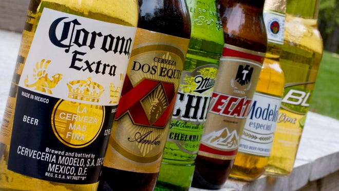 Various bottled beers are seen in grocery stores.