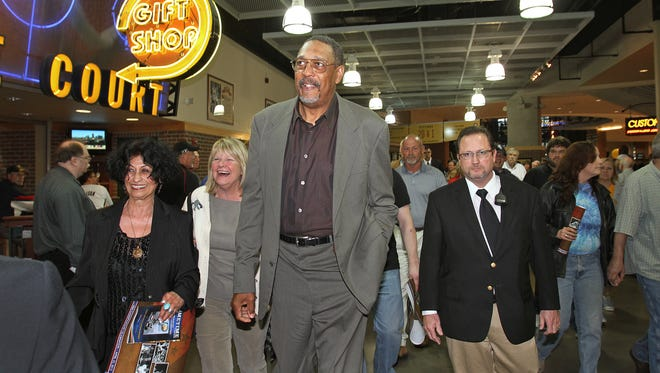 ABA and Pacers Legend Mel Daniels, center, was a fixture around the team, often giving advice to young players.