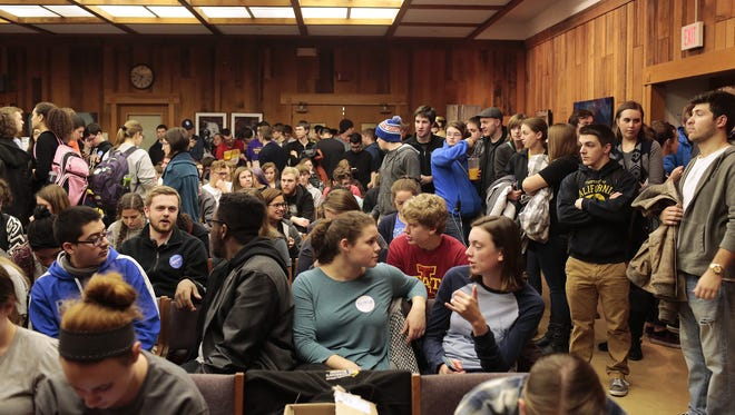 Students flood the room as they wait to vote on which democrat presidential candidate they'd like nominated at the Democratic Caucus on Feb. 1, 2016, in the Pioneer Room at the Memorial Union in Ames, Iowa.
