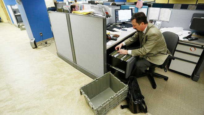 Reporter Ron Wilkins clears out his files on the last day of operations for the Journal & Courier Thursday, May 12, 2016, at its downtown Lafayette location. The J&C begins a news chapter in a new building on Lafayette's east side Monday, May 16.