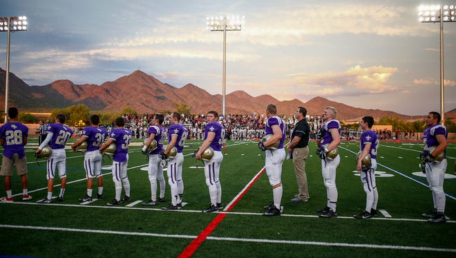Scottsdale Notre Dame Prep players wait for the game to begin against Waddell Shadow Ridge at Notre Dame Preparatory High School on August 19, 2016