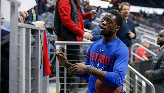 Dec 14, 2017; Atlanta, GA, USA; Detroit Pistons guard Reggie Jackson signs autographs before a game against the Atlanta Hawks at Philips Arena.