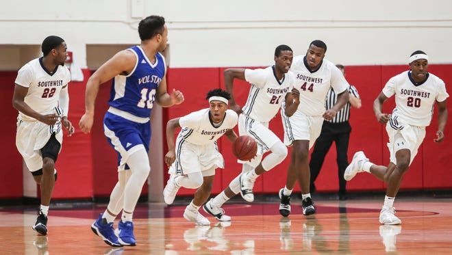 Michael Littlejohn (1) is one of several talented players on this year's Southwest Tennessee basketball team who have learned to sacrifice their games for the greater good.