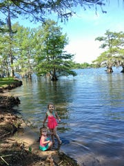 Sisters Avery and Marie Guidry enjoy the beach area of Lake Bruin State Park in St. Joseph.
