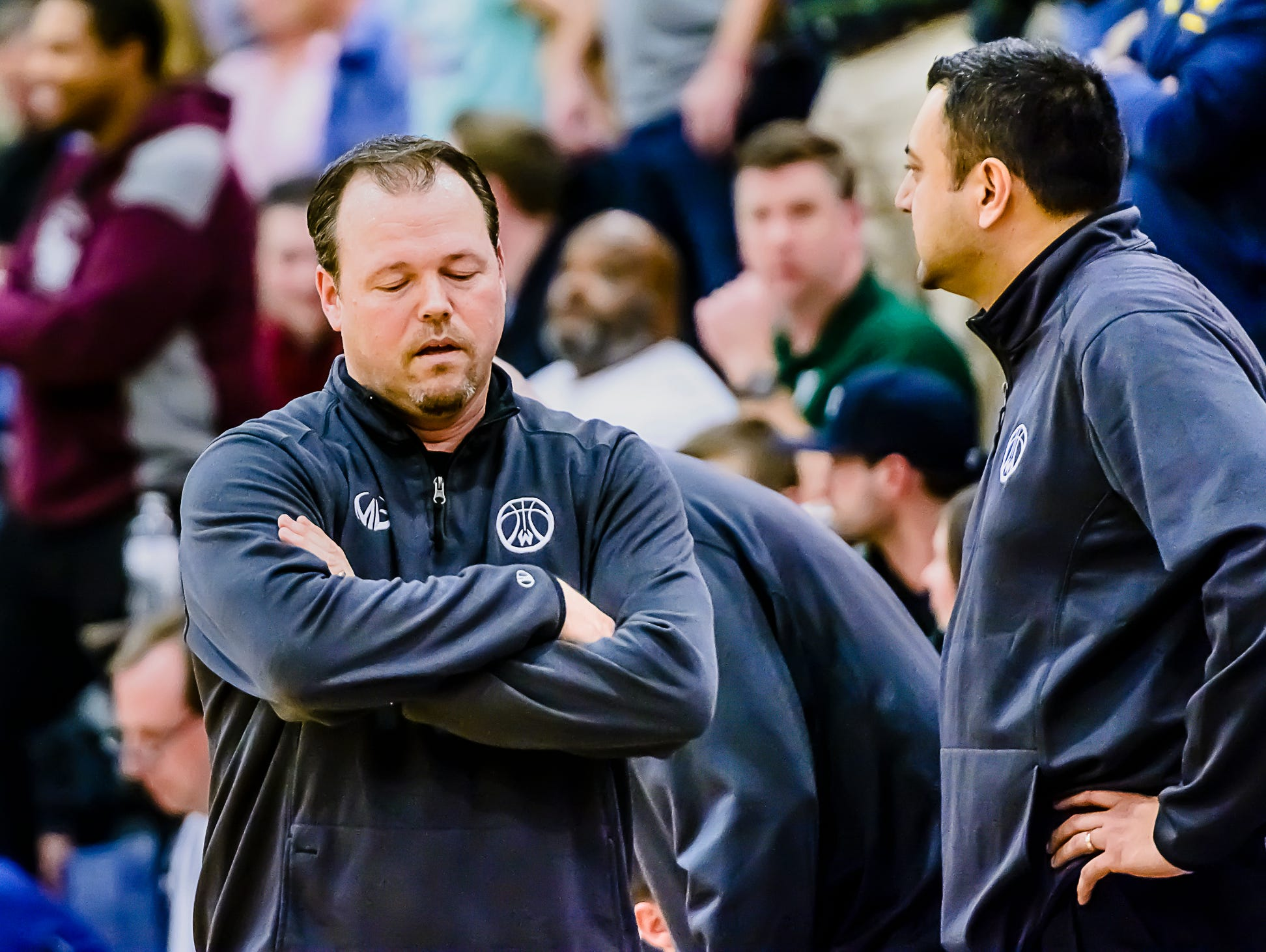 Williamston Boys Basketball Head Coach Tom Lewis ,left, reacts after River Rouge hit a 3-point shot to take a 54-51 lead with 3.8 seconds remaining in their Class B state quarterfinal game Tuesday March 21, 2017 at Chelsea High School in Chelsea. KEVIN W. FOWLER PHOTO