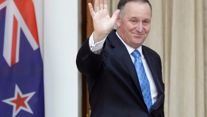 FILE - In this Oct. 26, 2016 file photo, New Zealand's Prime Minister John Key waves to media before his meeting with Indian counterpart Narendra Modi in New Delhi, India. John Key stunned the nation on Monday, Dec. 5 when he announced he was resigning after eight years as leader. (AP Photo/Manish Swarup, File) ORG XMIT: TKMY101