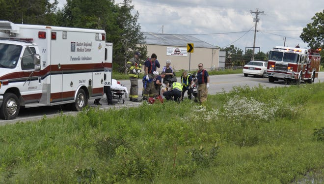 Emergency personnel tend to 54-year-old Tommy McBride of Mountain Home after he struck a deer Tuesday morning. McBride was riding his motorcycle North on Arkansas State Highway 5 north when the deer ran into his 1999 Honda Shadow.