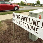 A hand-lettered sign on M-36 in Putnam Township protests the proposed pipeline.