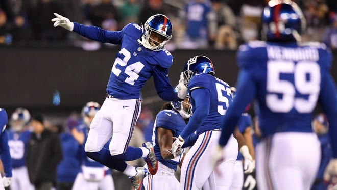 New York Giants cornerback Eli Apple (24) celebrates as the Giants defense take the field after an Odell Beckham (not pictured) touchdown in the third quarter. The New York Giants defeated the Dallas Cowboys 10-7 in Week 14 at MetLife Stadium in East Rutherford, NJ on Sunday, December 11, 2016.