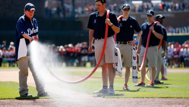 Detroit Tigers head groundskeeper Heather Nabozny wets down the field prior to the start of the Detroit Tigers and Chicago White Sox game at Comerica Park in Detroit on Saturday April 18, 2015 in Detroit.