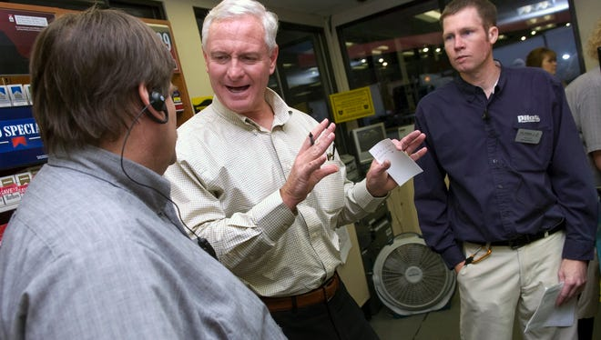 Jimmy Haslam, center, president and CEO of Pilot Travel Centers, visits with managers Gary Jones, left, and Jim Kennedy Nov. 16, 2010 at the Flying J Travel Center at Watt Road in Knoxville, Tenn. Pilot Travel Centers and Flying J merged in June of 2010, with the company now operating more than 550 travel centers across North America. (Amy Smotherman Burgess/News Sentinel)