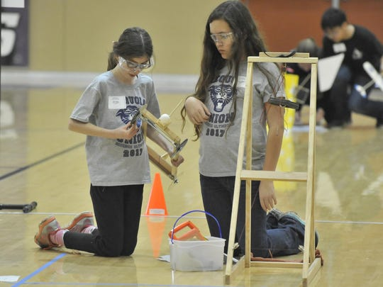 Chloe Kaiser and Savannah Breshears of Sequoia Union Elementary put the finishing touches on their scrambler Division B during The Tulare County Office of Education held the Tulare County Science Olympiad at Mission Oak on March 4, 2017.