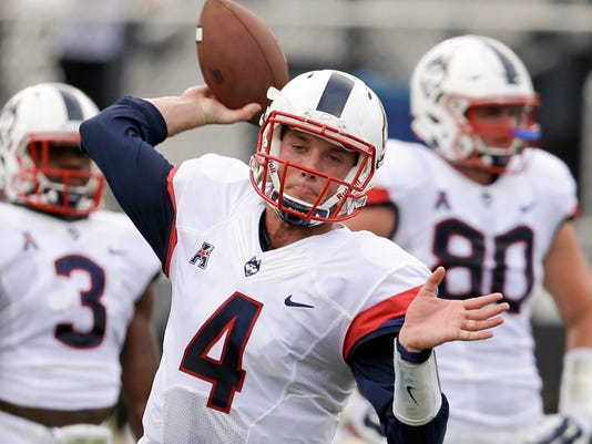 Connecticut quarterback Bryant Shirreffs (4) warms up before an NCAA college football game against Central Florida, Saturday, Oct. 10, 2015, in Orlando, Fla. (AP Photo/John Raoux)