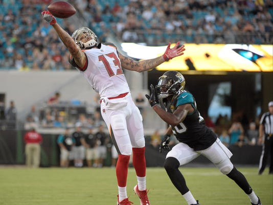 FILE - In this Aug. 20, 2016, file photo, Tampa Bay Buccaneers wide receiver Mike Evans (13) reaches for an incomplete pass as Jacksonville Jaguars cornerback Jalen Ramsey defends during an NFL preseason football game in Jacksonville, Fla. Evans should thrive in new coach Dirk Koetter's system, which helped Roddy White and Julio Jones become superstars in Atlanta. Evans and quarterback Jameis Winston have a year together so expect them to develop into one of the top QB-WR tandems in the league. (AP Photo/Phelan M. Ebenhack, File)