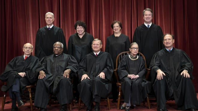 The justices of the U.S. Supreme Court gather for a group portrait in 2018. Seated from left: Associate Justice Stephen Breyer, Associate Justice Clarence Thomas, Chief Justice of the United States John G. Roberts, Associate Justice Ruth Bader Ginsburg and Associate Justice Samuel Alito Jr.  Standing behind from left: Associate Justice Neil Gorsuch, Associate Justice Sonia Sotomayor, Associate Justice Elena Kagan and Associate Justice Brett M. Kavanaugh.