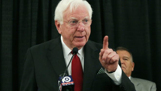 In this Nov. 10, 2016 photo, former Texas Gov. Mark White points to an audience of Baylor University alumni who gathered for a press conference demanding reform concerning the ongoing campus-wide sexual assault scandal, in Waco, Texas. White, a Democrat who championed public education reforms, has died. He was 77.